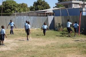 Haiti boy with crutch