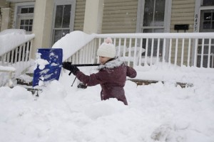 girl shovelling