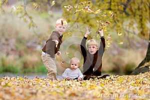 three-young-children-playing-fallen-leaves-happy-including-two-boys-their-baby-sister-throwing-yellow-silver-maple-61729757